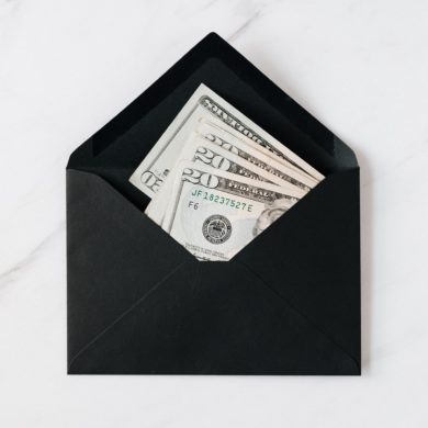 Stock image of money in an envelope