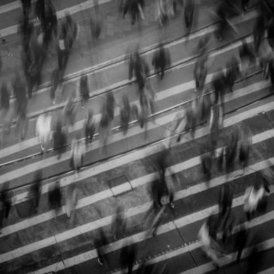 Black and white image of a busy cross walk