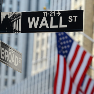 Stock image of American flag and Wall St. New York