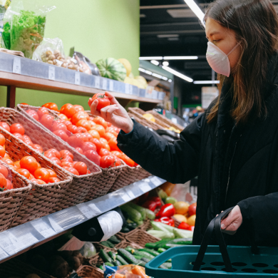 Stock image a female grocery shopping for healthy food